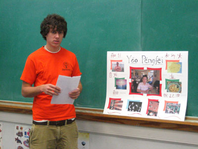 a male student addresses the class