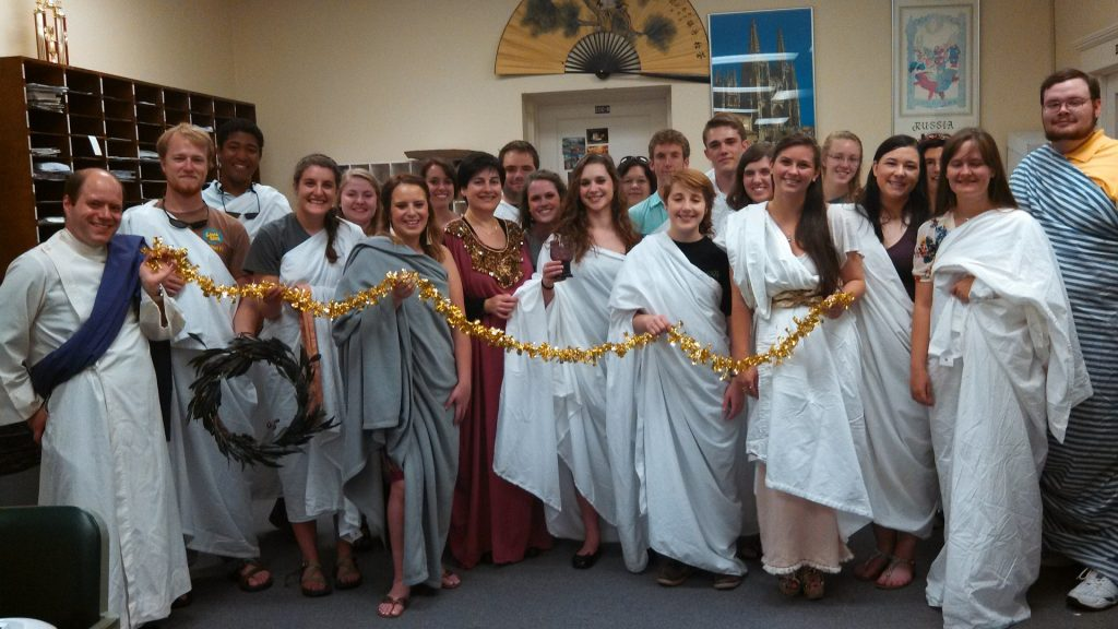 a group of students wearing togas over their street clothes