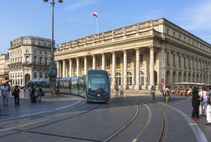 Modern tram on the Place de la Comédie in Bordeaux, France.
