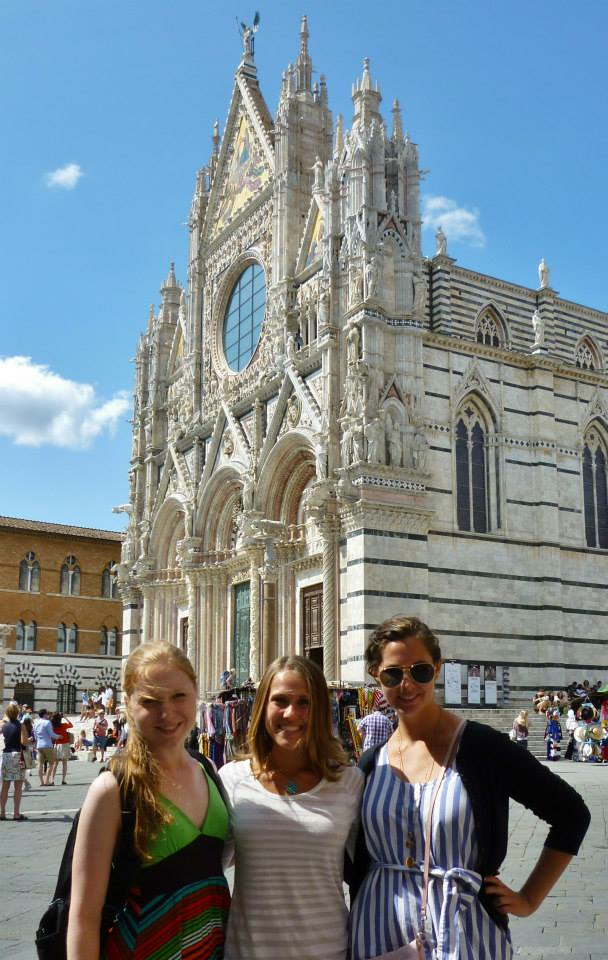 three UA students pose in front of a cathedral