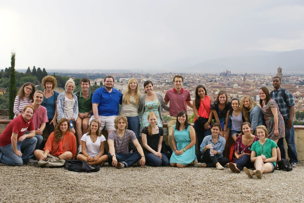a group of UA students poses atop a hill overlooking Florence, Italy
