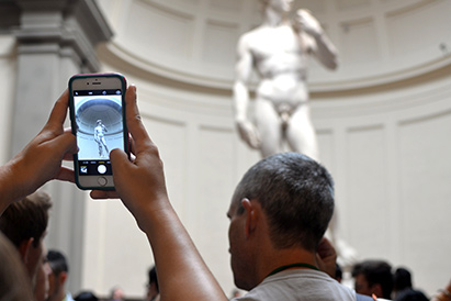 tourists taking photos of Michelangelo's David