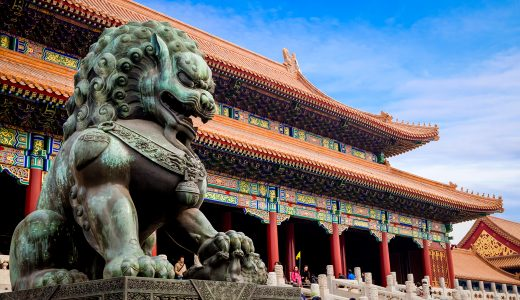 lion statue outside a Chinese temple