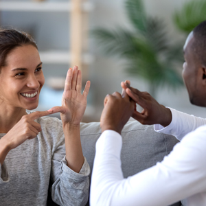 two people communicating via sign language